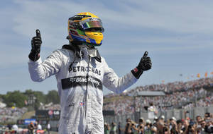 Photo - Mercedes driver Lewis Hamilton of Britain celebrates after winning the Hungarian Formula One race at the Hungaroring racetrack, near Budapest, Hungary, Sunday, July 28, 2013. (AP Photo/Bela Szandelszky)