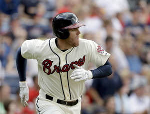 Photo - Atlanta Braves' Freddie Freeman runs the bases after hitting a two-run home run to score teammate Justin Upton, not pictured, in the third inning of a baseball game against the Arizona Diamondbacks, Saturday, June 29, 2013, in Atlanta. (AP Photo/David Goldman)
