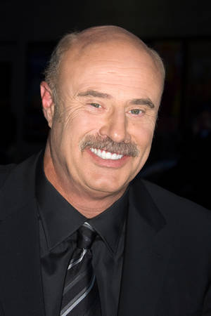 "FILE - In this March 4, 2009 file photo, Dr. Phil McGraw arrives for a taping of ""The Late Show with David Letterman"" in New York. (AP Photo/Charles Sykes, file) ORG XMIT: NYET509"