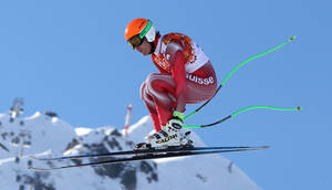 Photo - Switzerland's Sandro Viletta jumps during the downhill portion of the men's supercombined at the Sochi 2014 Winter Olympics, Friday, Feb. 14, 2014, in Krasnaya Polyana, Russia. (AP Photo/Luca Bruno)