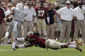 Photo - Florida State's Ronald Darby, right, makes a diving tackle on Nevada's Richy Turner in the first quarter of an NCAA college football game on Saturday, Sept. 14, 2013, in Tallahassee, Fla.(AP Photo/Steve Cannon)