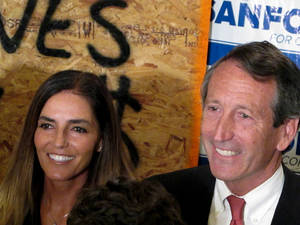 Photo - Maria Belen Chapur and her fiancee, former South Carolina Gov. Mark Sanford pose for a picture in Mount Pleasant, S.C., on Tuesday, April 2, 2013, after Sanford won the GOP nomination for the U.S. House seat he once held. Sanford is trying to make a comeback after his political career was derailed four years ago when he disappeared from the state only to return to admit the couple was having an affair. Sanford's wife, Jenny, later divorced him. (AP Photo/Bruce Smith)