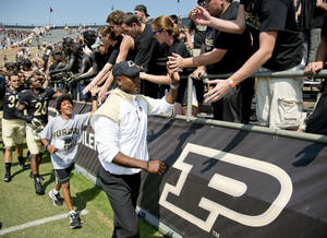 Photo - Purdue's Darrell Hazell greets the fans following his first win as head coach against Indiana State 20-14 during the second half of an NCAA college football game at Ross-Ade Stadium, in West Lafayette, on Saturday, Sept. 7, 2013. (AP Photo/Journal & Courier, Brent Drinkut)