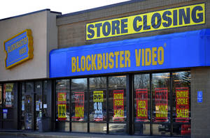 Photo - A closing Blockbuster store is shown in March 2010 in Racine, Wis. Dish Network announced Wednesday it will close the remaining 300 Blockbuster locations scattered across the United States.  AP Archives Photo