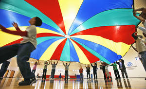 Photo - In this file photo from 2010, students play a parachute game at the  Boys and Girls Club. PHOTO BY DAVID MCDANIEL, THE OKLAHOMAN. <strong>David McDaniel</strong>