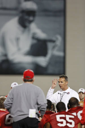 photo - Ohio State coach Urban Meyer talks to his team during the NCAA college football team's first day of spring practice at the Woody Hayes Athletic Center, Tuesday afternoon, March 5, 2013, in Columbus, Ohio. (AP Photo/The Columbus Dispatch, Eamon Queeney)