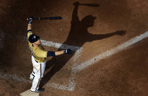 Photo - Milwaukee Brewers' Jonathan Lucroy watches a foul ball during the eighth inning of a baseball game against the Los Angeles Angels, Sunday, Sept. 1, 2013, in Milwaukee. (AP Photo/Morry Gash)