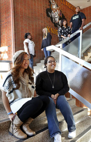 photo - Northwest Classen High School students are shown on campus Wednesday. Seated in foreground are Huyen Nguyen, left, and Mackenzie Renfrow. Next level are Chaquion Joyner and Bethani Snow. Leaning against railing are Alexis Southammavong and Terrance Lowery. Photo by Jim Beckel, The Oklahoman