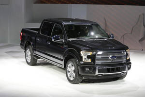 Photo - Ford unveils the new F-150 with a body built almost entirely out of aluminum. at the North American International Auto Show in Detroit, Monday, Jan. 13, 2014. (AP Photo/Carlos Osorio)