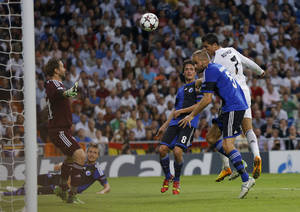 Photo - Real's Cristiano Ronaldo, right scores with a header during the Champions League group B soccer match between Real Madrid and FC Copenhagen at the Santiago Bernabeu stadium in Madrid, Wednesday, Oct. 2, 2013. (AP Photo/Daniel Ochoa de Olza)