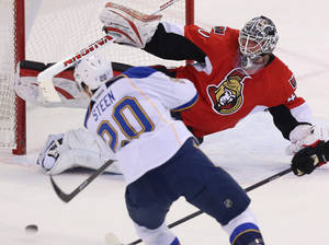 Photo - Ottawa Senators goaltender Robin Lehner (40) makes a pad save on St.Louis Blues Alexander Steen (20) during second period NHL hockey action in Ottawa Monday, Dec. 16, 2013. (AP Photo/The Canadian Press, Fred Chartrand)