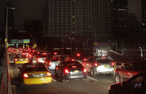 Photo -   Early morning commuters cross New York's Brooklyn Bridge, Wednesday, Oct. 31, 2012. Morning rush-hour traffic appeared thicker than on an ordinary day as people started to return to work in a New York without functioning subways. Cars were bumper-to-bumper on several major highways. (AP Photo/Richard Drew)