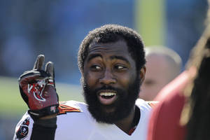 Photo - FILE - In this Dec. 1, 2013 file photo, Tampa Bay Buccaneers' Darrelle Revis clowns around with teammates during warm ups before an NFL football game against the Carolina Panthers in Charlotte, N.C. As Day 2 of the NFL's free-agency period began to unfold, Carolina Panthers receiver Steve Smith and Tampa Bay Buccaneers cornerback Darrelle Revis were waiting to find out whether they might be traded or released. (AP Photo/Bob Leverone, File)