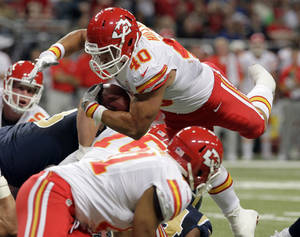 Photo -   Kansas City Chiefs running back Peyton Hillis, top, dives into the end zone for a one-yard touchdown run during the second quarter of a preseason NFL football game against the St. Louis Rams, Saturday, Aug. 18, 2012, in St. Louis. (AP Photo/Seth Perlman)