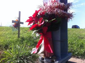 Photo - A roadside memorial can be seen on Lake Hefner Parkway in Oklahoma south of Britton Road. Such markers are common at locations where people have lost loved ones. <strong>The Okalhoman - ROBERT MEDLEY</strong>