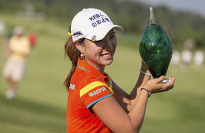 Photo - Hee Young Park, of South Korea, holds the trophy after winning the Manulife Financial LPGA Classic golf tournament on the third hole of a playoff, in Waterloo, Ontario, Sunday, July 14, 2013. (AP Photo/The Canadian Press, Geoff Robins)
