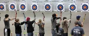 Photo -  Students line up to shoot in last year's Archery in the Schools state tournament. Photo By David McDaniel, The Oklahoman Archives     <strong> -  By David McDaniel, The Oklahoman </strong>
