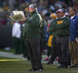 Photo -   Sun reflects back into the face of Green Bay Packers coach Mike McCarthy during the second half of an NFL football game Sunday, Oct. 28, 2012, in Green Bay, Wis. The Packers won 24-15. (AP Photo/Mike Roemer)