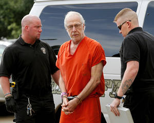 Photo - Gary Doby, a former professor at Oklahoma Baptist University, arrives Monday at the Pottawatomie County Courthouse for the hearing. Photos by Jim Beckel, The Oklahoman