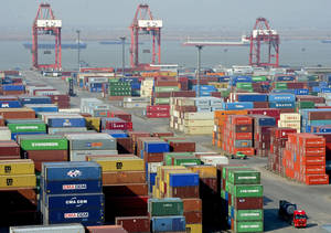 Photo -   FILE - In this Dec. 10, 2011, file photo, a truck leaves a port in Nanjing in east China's Jiangsu province. Cheap imports of goods from China have benefited American consumers and helped keep inflation down. But those imports have hurt American manufacturers, and many U.S.-based companies outsource production to China to cut costs, which has also caused U.S. job losses. One study estimated that between 2001 and 2010, 2.8 million U.S. jobs were lost or displaced to China, the world's second largest economy. (AP Photo) CHINA OUT