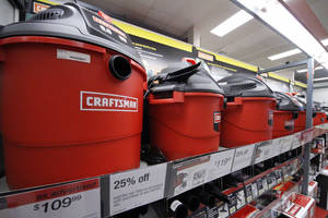photo -   In this May 18, 2011 photo, a display of Wet/Dry vacuums is shown at a Sears store in Bethel Park, Pa. The company reported Thursday Aug. 16, 2012 that it lost $132 million, or $1.25 per share, for the period ended July 28. That compares with a loss of $146 million, or $1.37 per share, a year ago. (AP Photo/Gene J. Puskar)