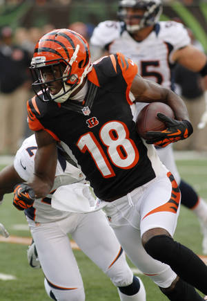 Photo -   Cincinnati Bengals wide receiver A.J. Green (18) runs after catching a pass against the Denver Broncos in the second half of an NFL football game, Sunday, Nov. 4, 2012, in Cincinnati. (AP Photo/Tom Uhlman)