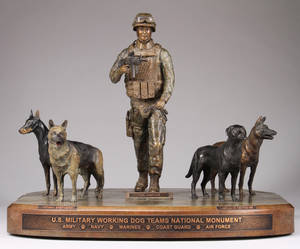 Photo -   This undated publicity photo provided by John Burnam Monument Foundation, Inc., shows the frontal view of the U.S. Military Working Dog Teams National Monument. It is the first national monument ever to pay tribute to dogs and honors every dog who has served in combat since World War II. (AP Photo/John Burnam Monument Foundation, Inc.)