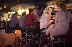 Photo - This undated image released by The Admiral restaurant shows patrons sitting at the bar of the restaurant in Asheville, N.C. Since opening in 2007, The Admiral has morphed from a neighborhood tavern into a destination restaurant. (AP Photo/The Admiral, Melissa Robinson)