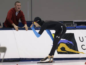 Photo - Emery Lehman celebrates after competing in the men's 10,000 meters during the U.S. Olympic speedskating trials Wednesday, Jan. 1, 2014, in Kearns, Utah. Lehman won the event. (AP Photo/Rick Bowmer)