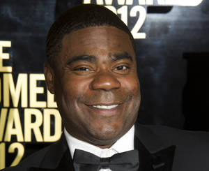 Photo - FILE - In this April 28, 2012, file photo, Tracy Morgan attends The Comedy Awards in New York. Morgan is suing Wal-Mart over the June 7, 2014, highway crash that seriously injured him and killed a fellow comedian. The lawsuit, filed Thursday, July 10, 2014, in U.S. District Court in New Jersey, claims Wal-Mart was negligent when a driver of one of its tractor-trailers rammed into Morgan's limousine. (AP Photo/Charles Sykes, File)
