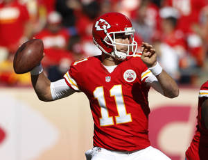 Photo - Kansas City Chiefs quarterback Alex Smith (11) throws a pass during the first half of an NFL football game against the Cleveland Browns in Kansas City, Mo., Sunday, Oct. 27, 2013. (AP Photo/Colin E. Braley)
