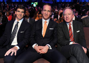 Photo - Eli Manning of the New York Giants, left, Peyton Manning of the Denver Broncos, center, and former NFL player Archie Manning at the 2nd Annual NFL Honors on Saturday, Feb. 2, 2013 in New Orleans. (Photo by Jordan Strauss/Invision/AP)