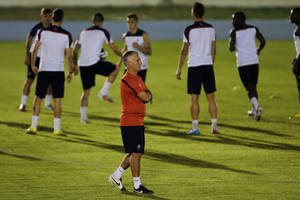 Photo - France's head coach Didier Deschamps walks on the field during an official training session at the Joao Havelange Olympic stadium, in Rio de Janeiro, Brazil, Tuesday, June 24, 2014. France will play its next game against Ecuador in group E of the 2014 soccer World Cup. A draw is enough to guarantee top spot for France, and would also send Ecuador through to the next round if Switzerland fails to beat Honduras in the other match. (AP Photo/David Vincent)