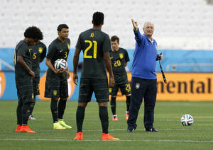 Photo - Brazil's coach Luiz Felipe Scolari gives directions to his players during an official training session the day before the group A World Cup soccer match between Brazil and Croatia in the Itaquerao Stadium Sao Paulo, Brazil, Wednesday, June 11, 2014. (AP Photo/Kirsty Wigglesworth)