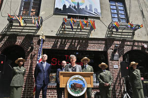 Photo - U.S. Interior Secretary Sally Jewell, center, speaks during a press conference outside The Stonewall inn announcing a national initiative for lesbian, gay, bisexual and transgender (LGBT) Americans on Friday May 30, 2014 in New York.  Jewel said the National Park Service will begin marking places of significance for LGBT Americans to mark their contributions to state and U.S. history.  (AP Photo/Bebeto Matthews)