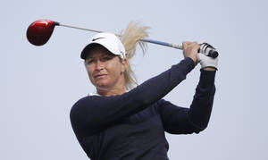 Photo - Suzann Pettersen, of Norway, watches her tee shot on the seventh green during the first round of the North Texas LPGA Shootout golf tournament at the Las Colinas Country Club in Irving, Texas, Thursday, May 1, 2014. (AP Photo/LM Otero)