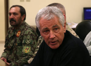 Photo - U.S. Secretary of Defense Chuck Hagel, right, speaks during a meeting with Afghan military leaders in Kandahar, Afghanistan, Sunday, Dec. 8, 2013. Hagel spoke with U.S. troops and thanked them for being deployed for the holidays. (AP Photo/Mark Wilson, Pool)