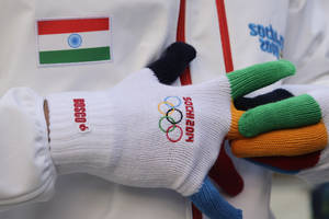 Photo - Indian luger Shiva Keshavan talks to reporters after a welcome ceremony for the Indian Olympic team at the Mountain Olympic Village at the 2014 Winter Olympics, Sunday, Feb. 16, 2014, in Krasnaya Polyana, Russia. (AP Photo/Jae C. Hong)