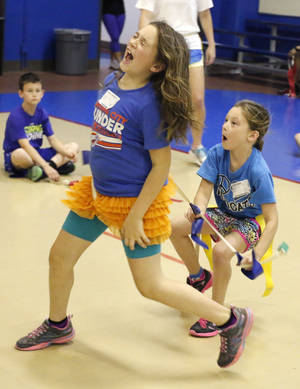 Photo -  Keelie Cullum, right, captures the flag of Abbey Hanselman during a summer sports camp at Oklahoma City Community College. Photo by Paul Hellstern, The Oklahoman  <strong>PAUL HELLSTERN -   </strong>