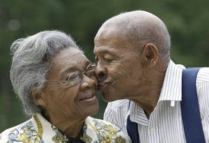 photo -   Roland Davis and Lena Henderson, both 85, kiss as they pose for a photo in West Seneca, N.Y., Tuesday, July 31, 2012. They got married while still in their teens, divorced 20 years later and are getting remarried on Saturday, August 4, after nearly a half-century apart. (AP Photo/David Duprey)