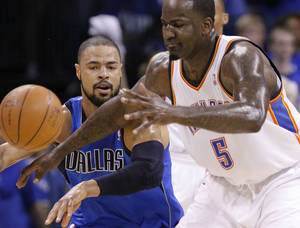 photo - Tyson Chandler (6) of Dallas knocks the ball away from Oklahoma City's Kendrick Perkins (5) during game 3 of the Western Conference Finals of the NBA basketball playoffs between the Dallas Mavericks and the Oklahoma City Thunder at the OKC Arena in downtown Oklahoma City, Saturday, May 21, 2011. Photo by Chris Landsberger, The Oklahoman
