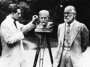 Photo - FILE - This is a 1931 file photo of Sigmund Freud, father of psychoanalysis, as he poses for sculptor Oscar Nemon in Vienna. British police are hunting burglars who tried to steal the ashes of psychoanalyst Sigmund Freud from a London crematorium. The Metropolitan Police force says a 2,300-year-old Greek urn containing the remains of Freud and his wife Martha was severely damaged in a break-in at Golders Green Crematorium on Dec. 31 or Jan. 1. (AP Photo/File)