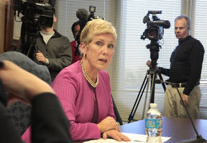 Photo - State schools Superintendent Janet Barresi is seen Tuesday at the Board of Education special meeting to certify and release A-F report cards for schools. Photo by David McDaniel, The Oklahoman <strong>David McDaniel</strong>