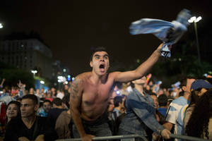 Photo - A fan of the Argentina national soccer team celebrates after his team defeated the Netherlands during a semifinals World Cup match, at the FIFA Fan Fest, in Sao Paulo, Brazil, Wednesday, July 9, 2014. Argentina made it to the World Cup final with a 4-2 shootout win over the Netherlands after the game finished in a 0-0 stalemate. (AP Photo/Rodrigo Abd)
