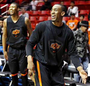 Photo - OSU's Markel Brown watches his shot during practice Thursday in San Diego.                    Photo by Bryan Terry, The Oklahoman