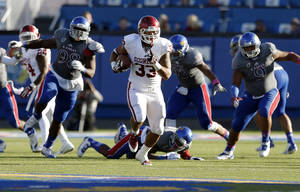 Photo - OU's Trey Millard outruns the Kansas defense in the third quarter on Saturday.  Photo by Sarah Phipps, The Oklahoman
