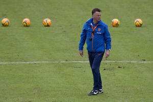 Photo - FILE - In this Thursday, May 15, 2014 file photo, Louis Can Gaal, coach of the Dutch national soccer team instructs his players during a training session,  in Hoenderloo, eastern Netherlands. Manchester United has hired Netherlands coach Louis Van Gaal as the club's new manager it was announced on Monday, May 19, 2014. Van Gaal, who will leave his position with the Dutch after the upcoming World Cup in Brazil, replaces David Moyes following his firing last month after just 10 months in charge.  (AP Photo/Peter Dejong, File)