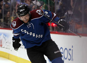 Photo - Colorado Avalanche center Marc-Andre Cliche celebrates after scoring his first goal in the NHL on a redirected shot against the Buffalo Sabres in the second period of an NHL hockey game in Denver, Saturday, Feb. 1, 2014. (AP Photo/David Zalubowski)