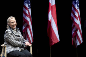 Photo -   US Secretary of State Hillary Clinton smiles during a forum with students at the Royal Library in Copenhagen, Denmark, Thursday May 31, 2012. (AP Photo/Saul Loeb, Pool)