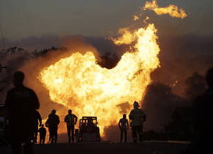 Photo - FILE - In this Sept. 9, 2010 file photo, a massive fire roars through a mostly residential neighborhood in San Bruno, Calif.   A report released Friday by the Department of Transportation's inspector general says the federal agency responsible for making sure states effectively oversee the safety of natural gas and other pipelines is falling down on the job.  (AP Photo/Paul Sakuma, File)